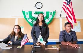 Group of 4-H leadership at table in front of club