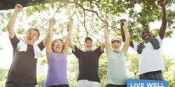 Faith Community members celebrating after workout. Standing under tree.