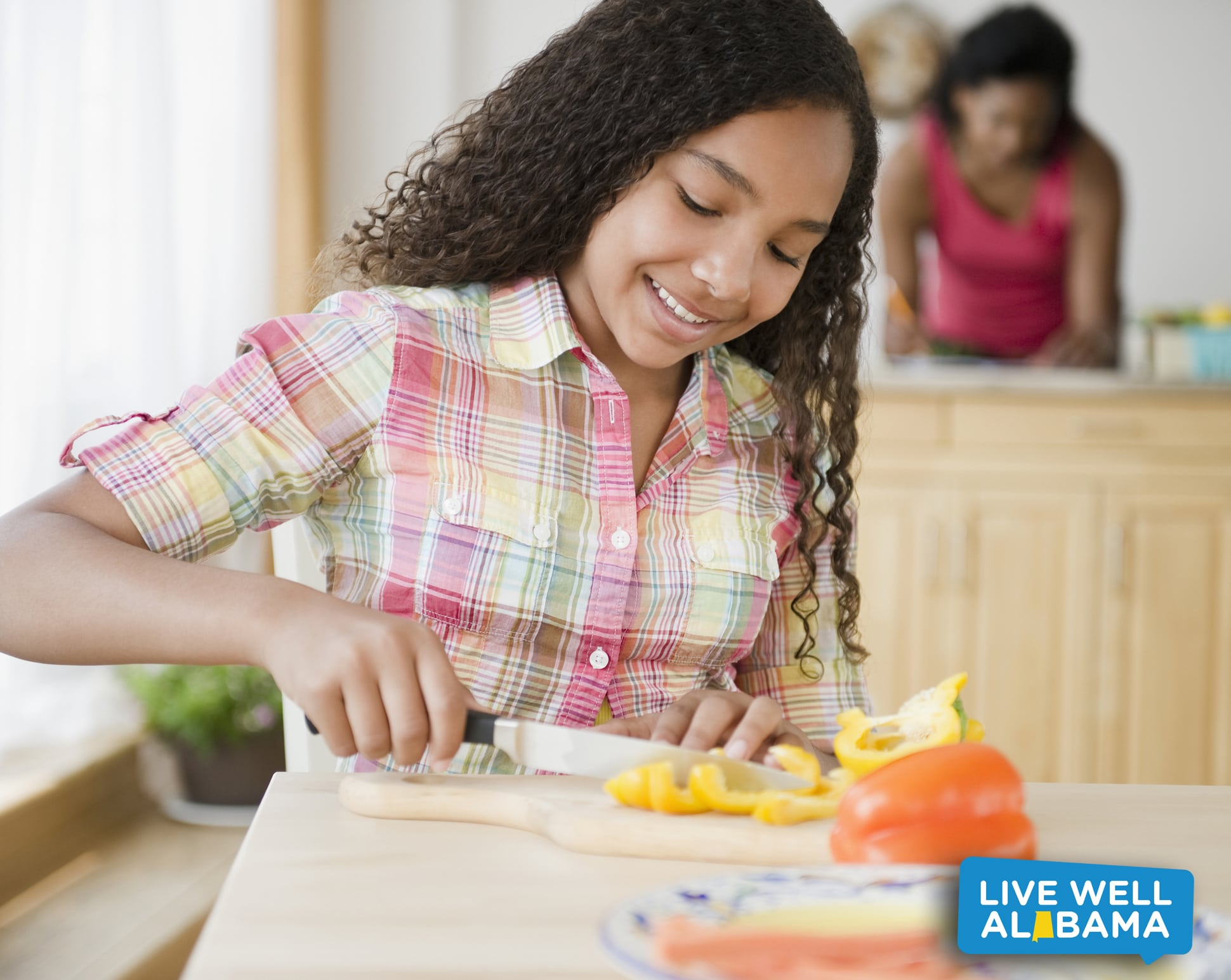 girl cutting bell peppers; featured social media image