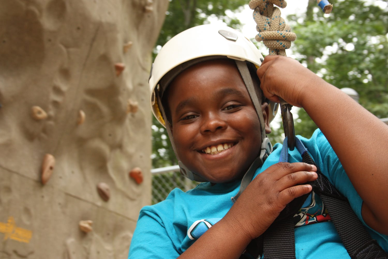4-H member on climbing wall