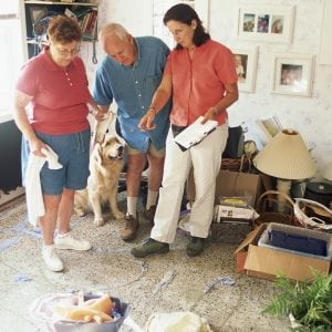 people assessing a damaged floor