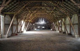 Empty rural barn with wooden supports
