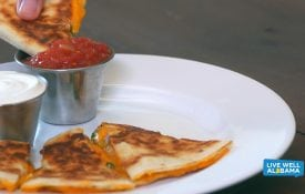 Cheesy quesadilla with spinach slices, dipped in salsa. Live Well Alabama recipe.