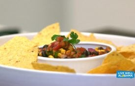 Live Well Alabama recipe, Tasty Taco Dip. Served with corn chips.