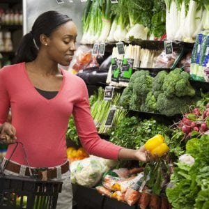 Black woman shopping for fresh vegetables