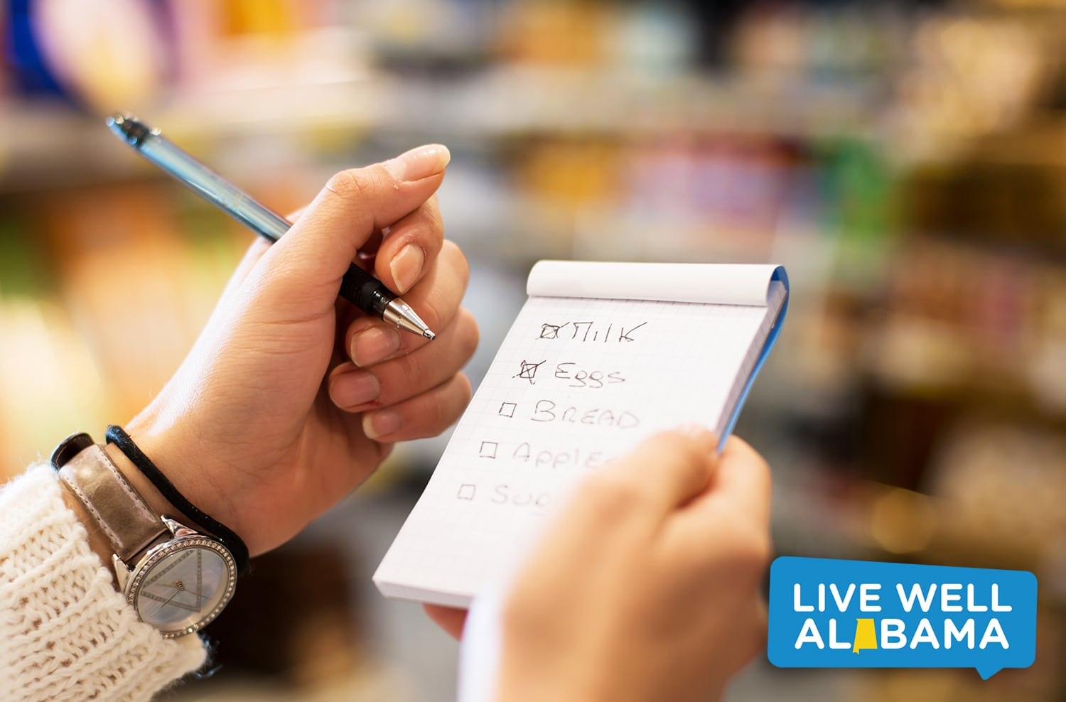 Young Woman with Shopping List at Supermarket