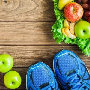 Fitness, healthy and active lifestyles concept: dumbbells, sport shoes, fruits and vegetable