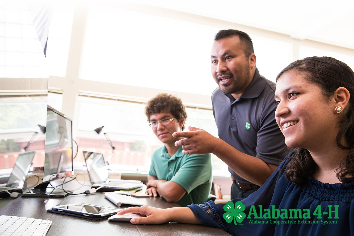 science and technology Alabama 4-H program members in front of computers