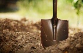 Soil with shovel. Close-up, shallow DOF. shutterstock.com/logoboom