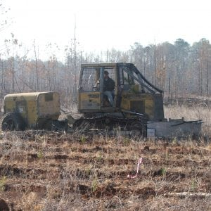 Contractor using a machine tree planter should take care not to allow fuel or oil leaks. (Photo credit: T.R. Clark)