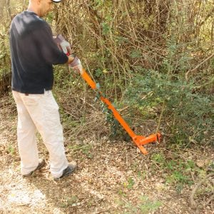 Figure 2. The weed wrench uses leverage to easily lift privet saplings out of the ground.