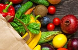 Full paper grocery bag of healthy food, fruits and vegetables