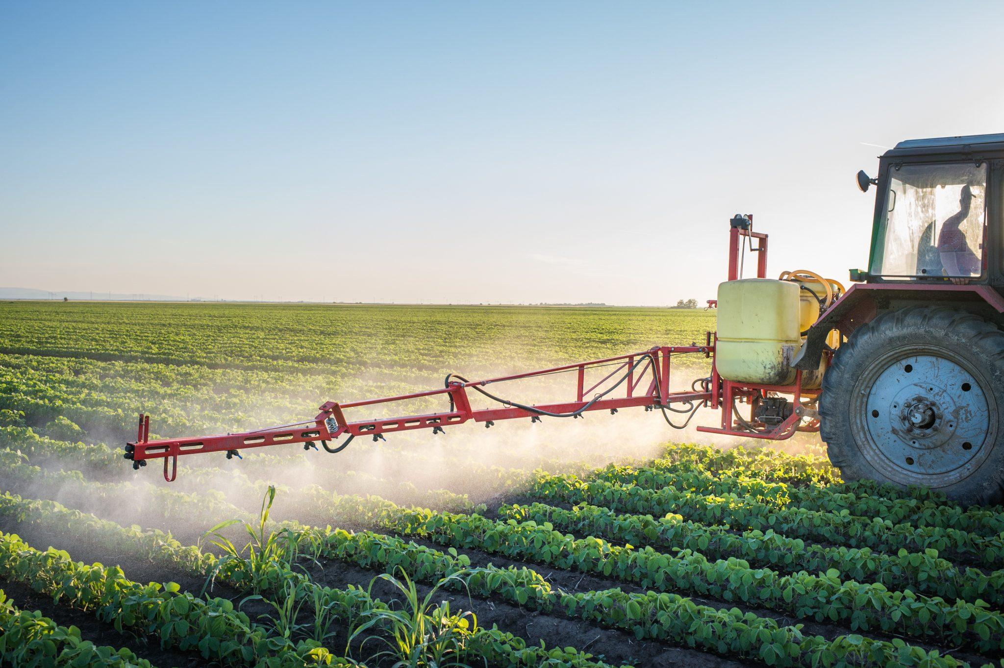spraying soybeans. shutterstock.com/Fotokostic