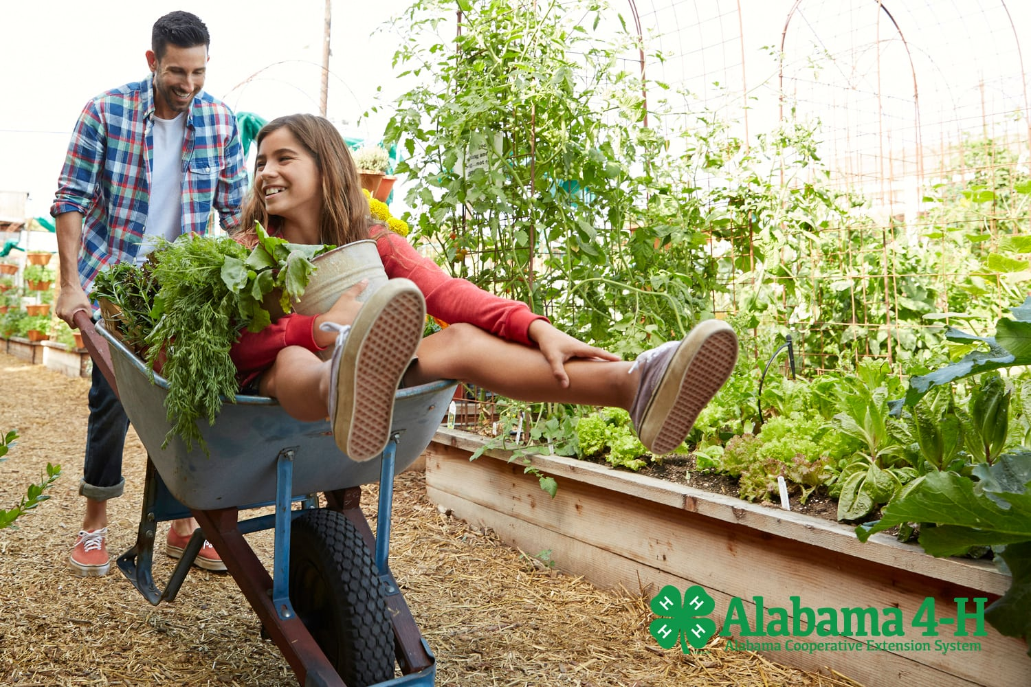 4-H father and daughter next to home garden. Alabama 4-H family.