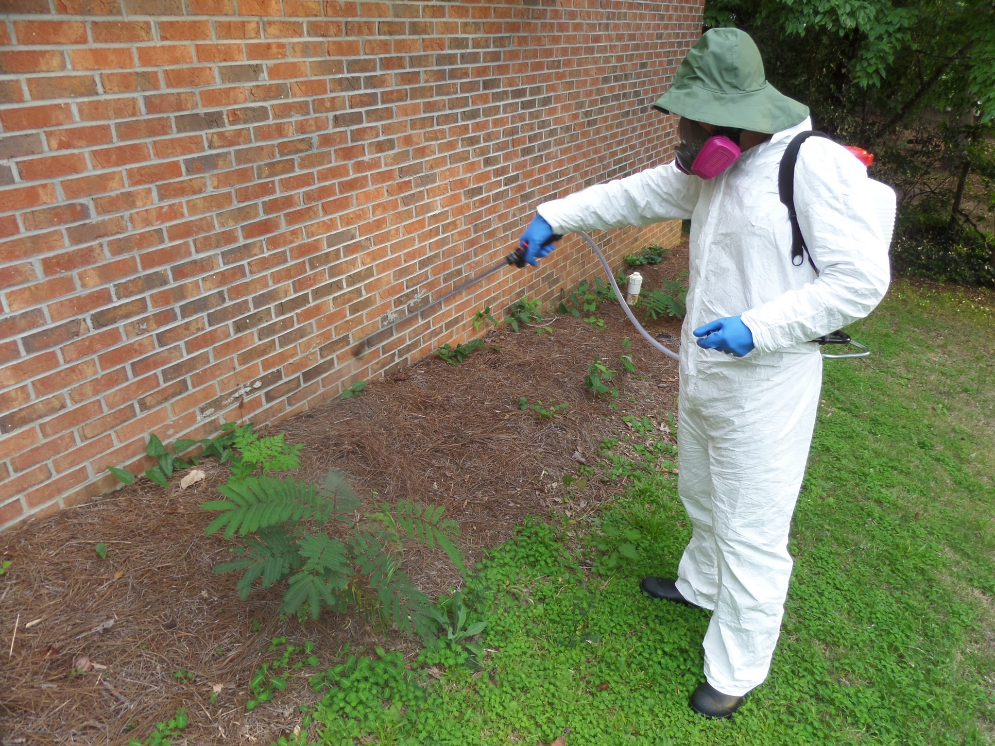 Applicator Spraying Pesticides in PPE