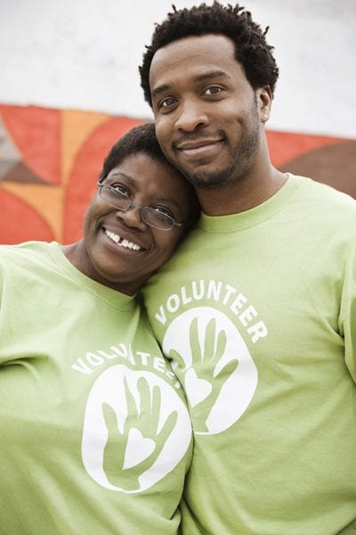 Alabama 4-H; two volunteers smiling together