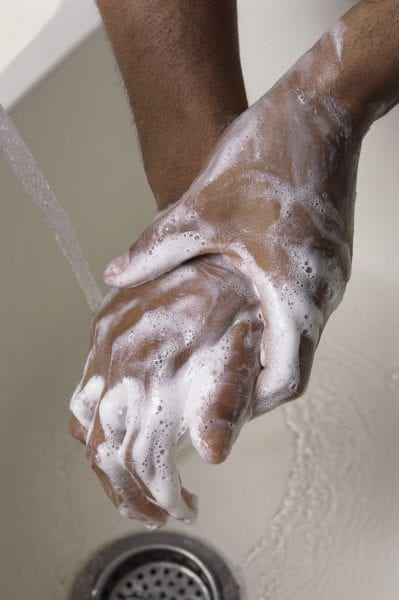 Close-up of a person washing hands with soap
