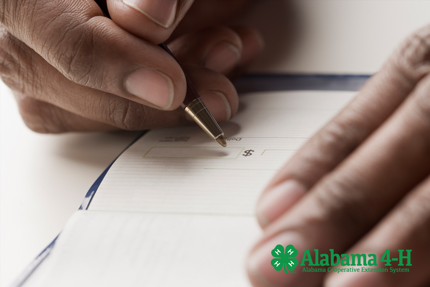 Alabama 4-H Foundation donation by mail; man writing check
