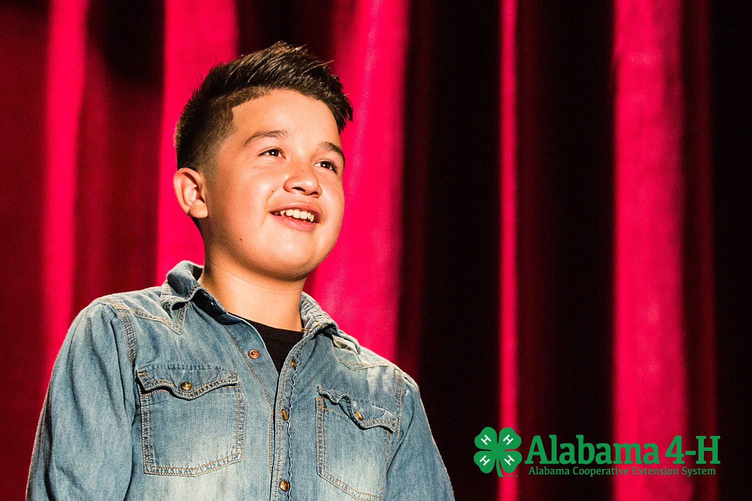 Alabama 4-H Junior Achievement; young boy speaking on stage