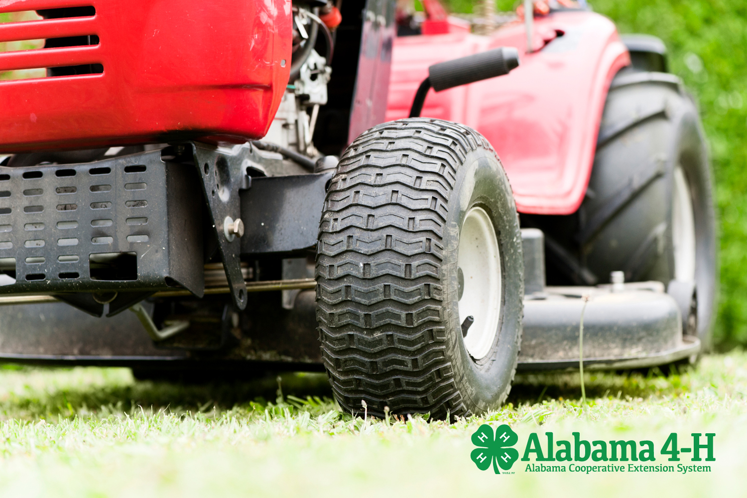 image of red lawn tractor part of the Alabama 4-H Lawn Tractor Project