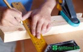 Alabama 4-H What Wood U Build participant with ruler