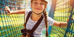 Alabama 4-H Character Counts curriculum; girl smiling on ropes course