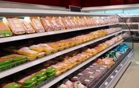 Fresh chicken meat on supermarket shelf
