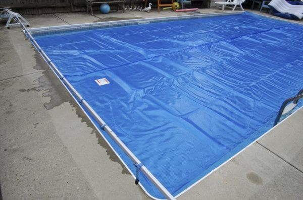 Solar pool cover on swimming pool