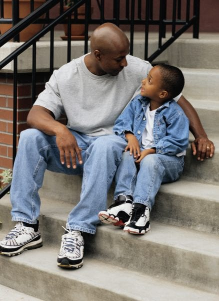 Father and Son Sitting on Stairs