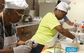 Live Well Faith Communities members cooking in kitchen