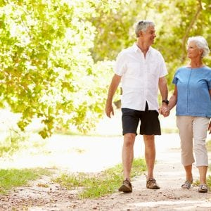Senior couple walking on a path together