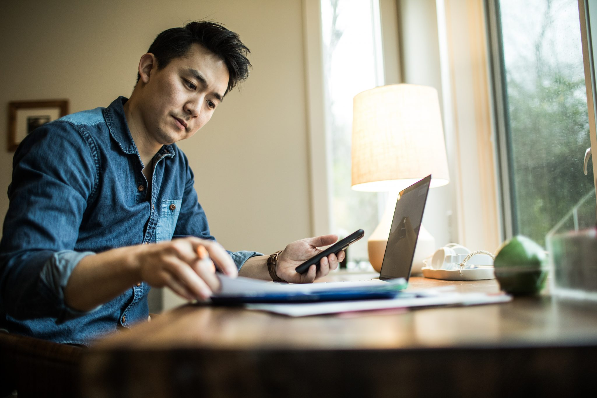 Man (early 30s) working in home office
