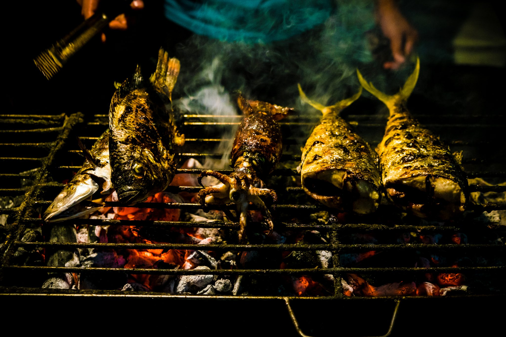 Close-Up Of Seafood On Barbecue Grill At Night