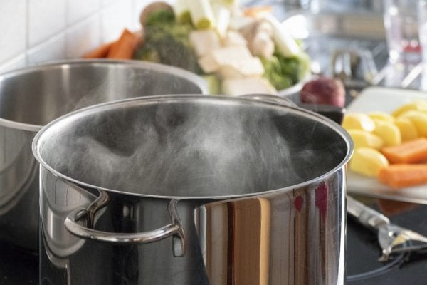 Blanching vegetables in big cooking pot preparation