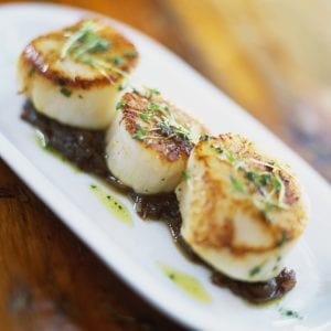 Grilled scallops on bed of onion confit