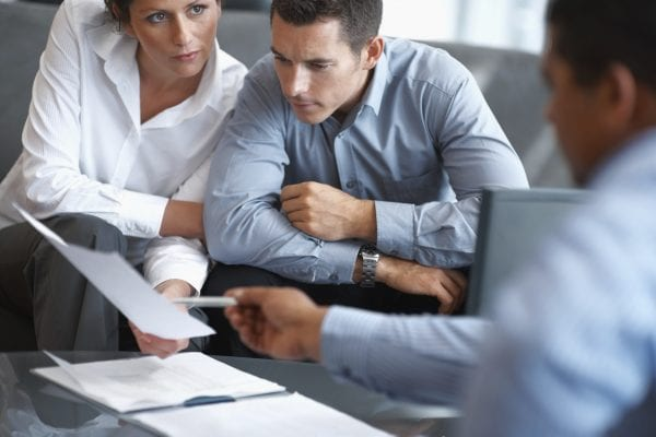 Financial Planning - Couple getting consulted