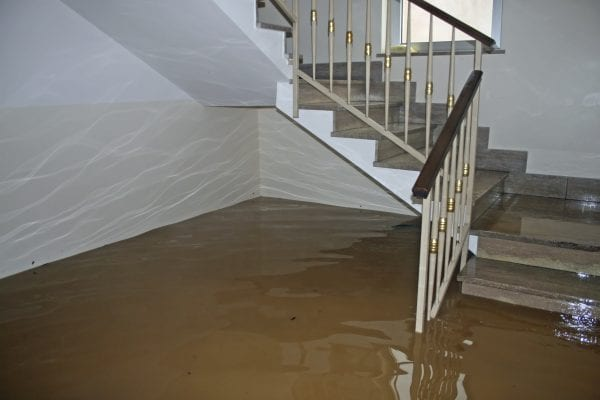 scale of a House fully flooded during the flooding