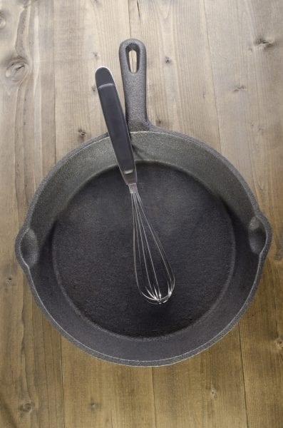 used cast iron pan an whisk