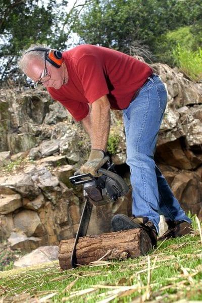 Man using chainsaw