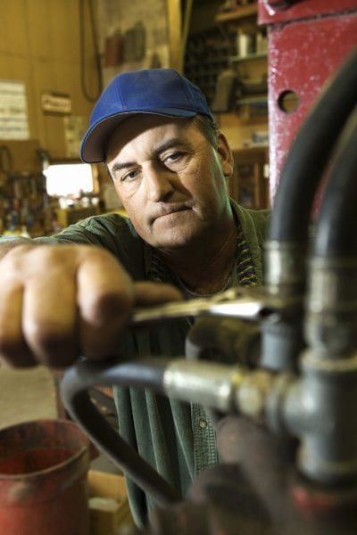 Man working on tractor engine