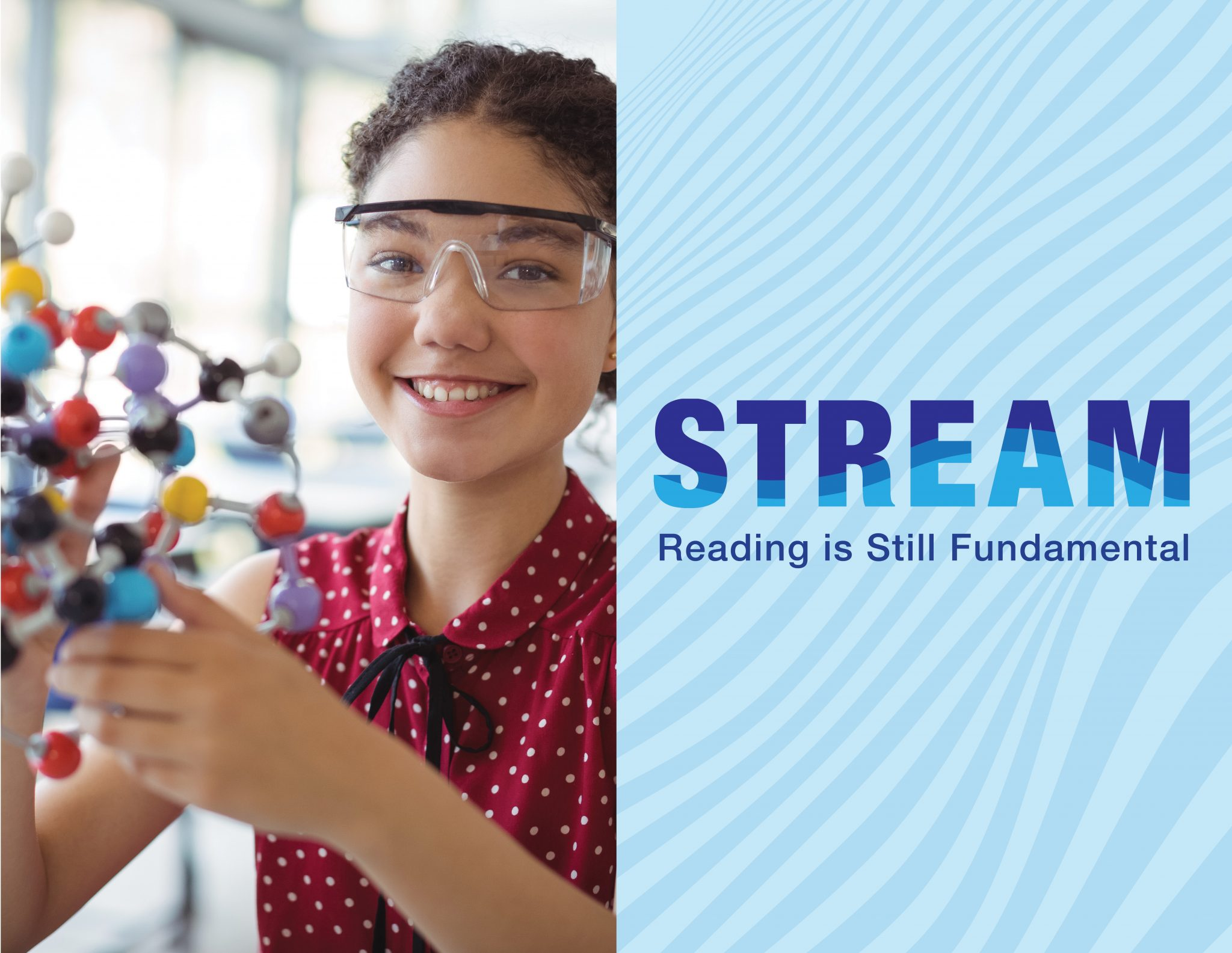 Girl wearing safety goggles examines a scientific model