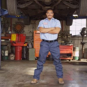 Portrait of auto mechanic in repair shop