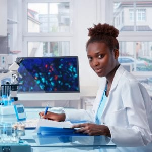 Female African scientist, medical worker, tech or graduate student works in modern biological laboratory.