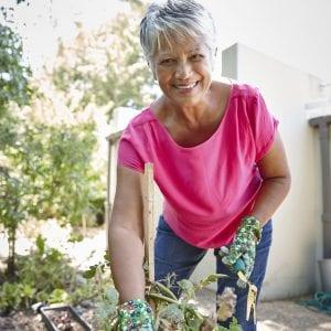 Older Hispanic woman in the garden