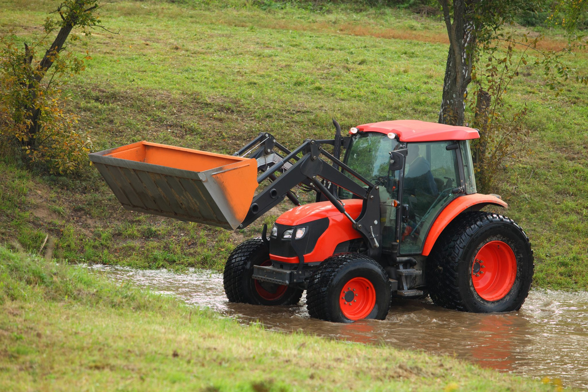 red tractor in flood