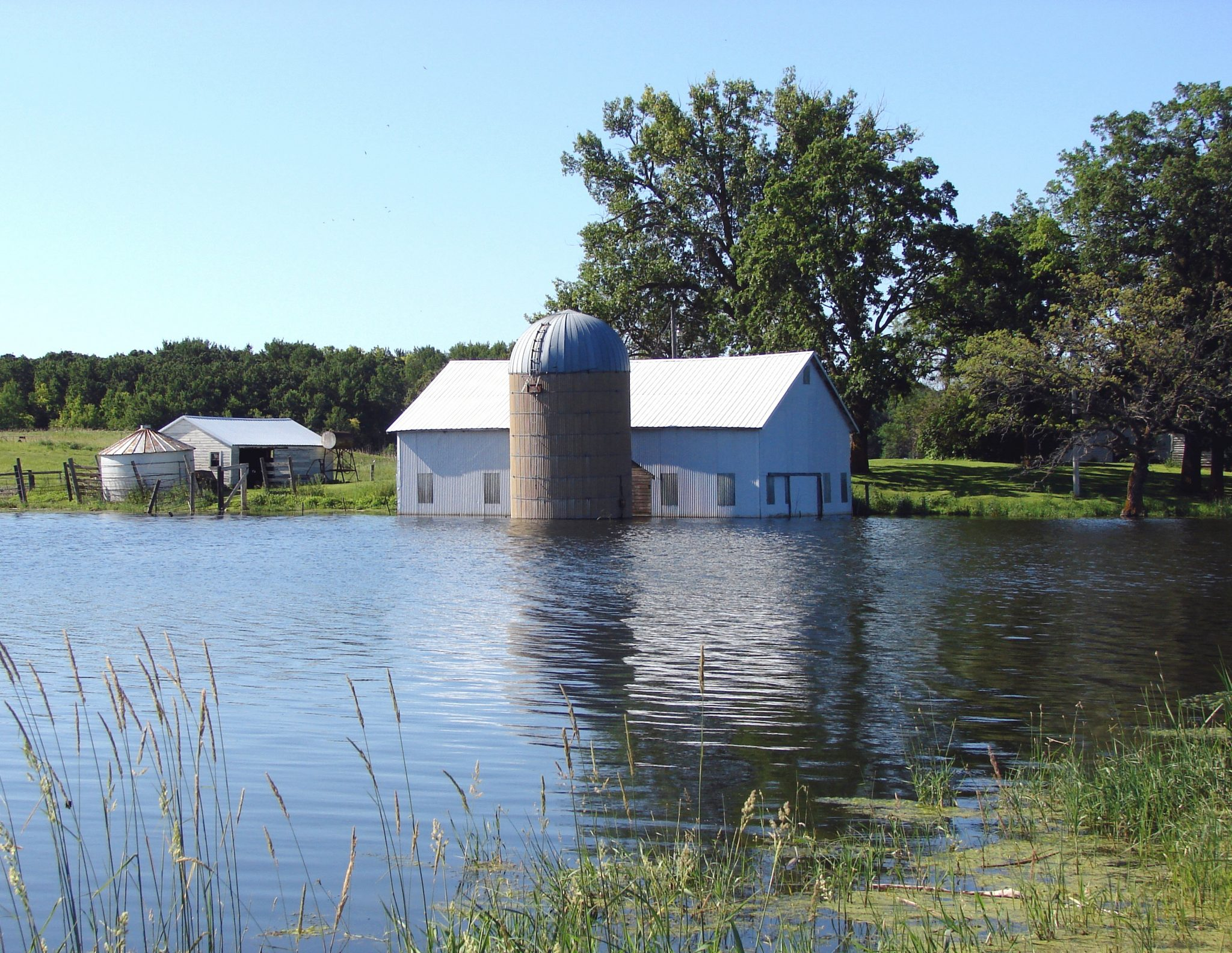 Barn in flooding water