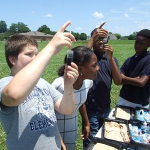 A group of students participating in water chemistry observations.