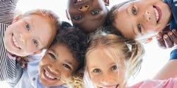 CATCH programs; Multiethnic children smiling in a circle