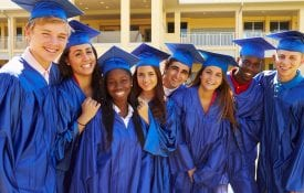 Graduating high school seniors in cap and gown