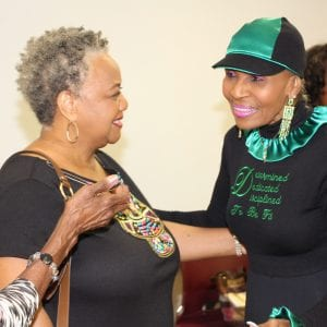 Two older adults greet SAI 2018 special guest speaker, Ernestine Shepherd